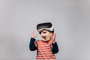 Kid having fun with VR glasses.