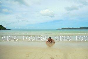 Man lying on the beach.