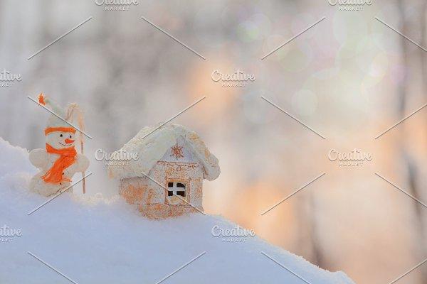 Christmas toy house, snowman, bokeh