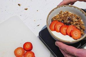 Serving the breakfast. White yogurt