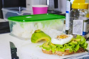 Healthy breakfast. Making a sandwich