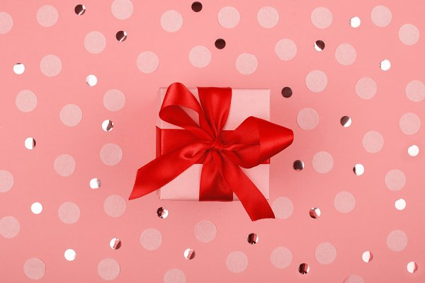 Christmas gifts with red ribbon
