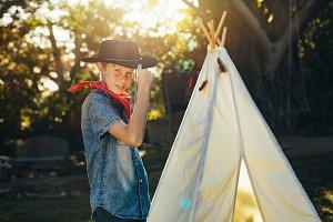 Little boy posing in cowboy hat