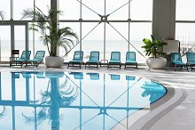 Spa area with swimming pool by  in Sports
