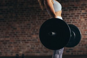 Woman exercises weight lifting