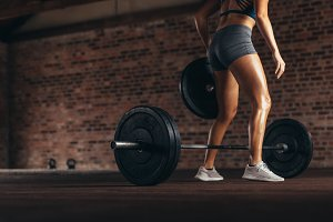 Athlete preparing barbell for weight