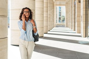 Smiling businesswoman walking