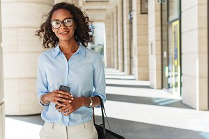Smiling woman holding a cell phone