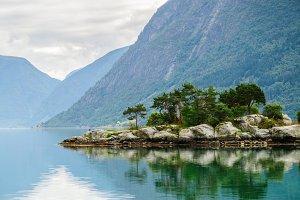 Small island at norwegian fjord
