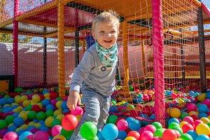 Happy little boy playing