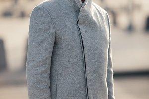 Toned photo of man in gray coat