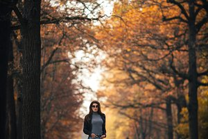 Photo of woman on alley in autumn