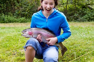 Teen Girl Catches Trout
