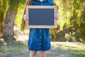 Mixed Race Girl with Chalkboard