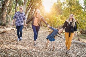 Mixed Race Friends Walk Outdoors