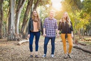Three Siblings Walking Outdoors