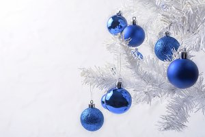 White Christmas tree with blue ornam