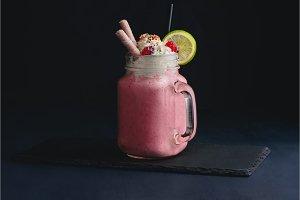 Cold strawberry milkshake in a