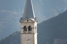 A bell tower. Church in Dolomites