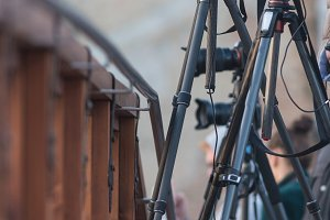 Cameras on tripods are on the bridge
