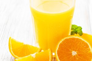 Glass of juice and orange fruits