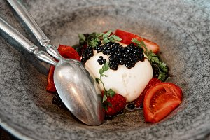 Burrata cheese with seaweed caviar