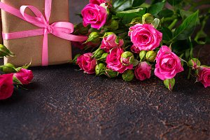 Pink roses and gift boxes with