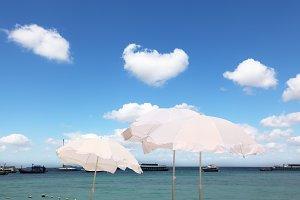 The white parasols on the sea breeze