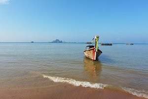 Easy Longtail boat dropped anchor in