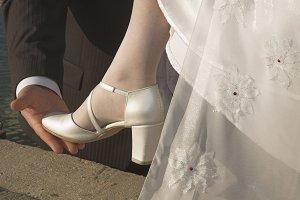 Under a heel.