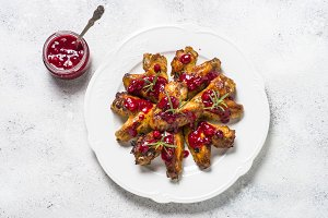 Baked chicken wings in cranberry