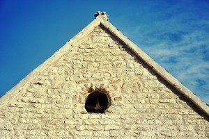 The triangular roof of an old buildi