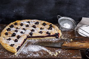 baked round black currant cake