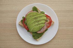 Sandwich with avocado slices and bac