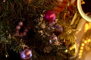 Christmas ball on tree with lights