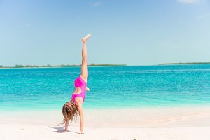 Active little girl at beach having a
