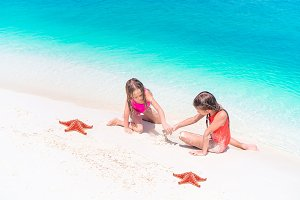 Adorable little girls with starfish