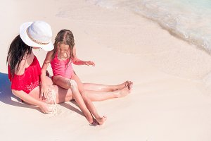 Familly on tropical beach. Mom and k