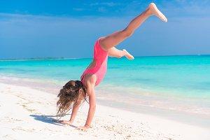 Adorable active little girl at beach