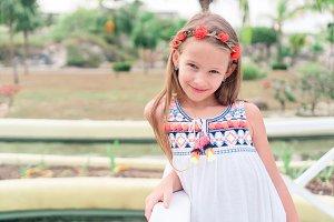 Adorable little girl walking along w