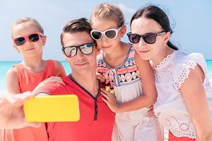 Young beautiful family taking selfie