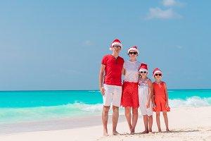Happy family on the caribbean beach