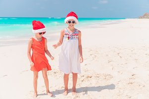 Little adorable girls in Santa hats