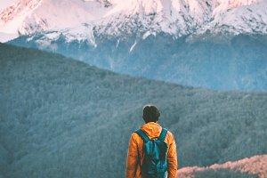 Traveler enjoying sunset mountains