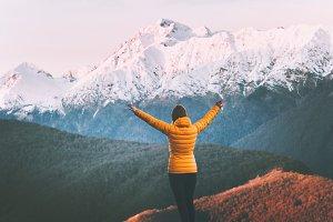Woman enjoying snowy mountains view
