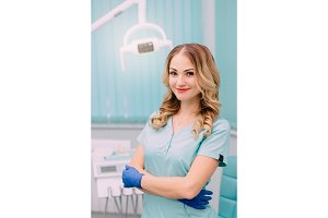 young female dentist in workplace