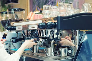 Barista is brewing coffee, toned