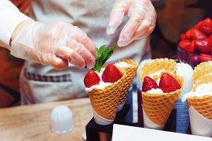 Pastry chef is decorating ice cream