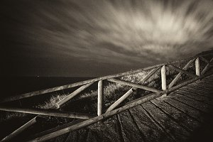 Wooden railing and clouds