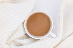 Cozy white warm sweater and Coffee C